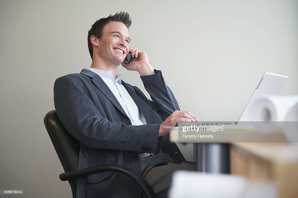 Businessman talking on cell phone : Photo