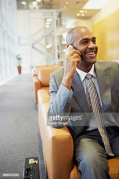 businessman talking on cell phone - oliver eltinger stock-fotos und bilder