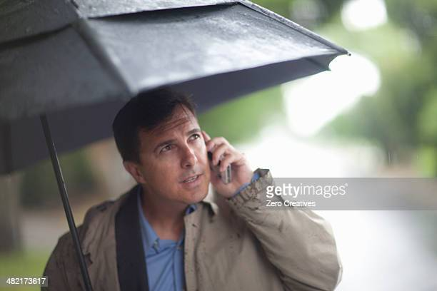 Man Umbrella Stock Photos And Pictures