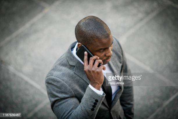 Businessman talking on his phone shot from above