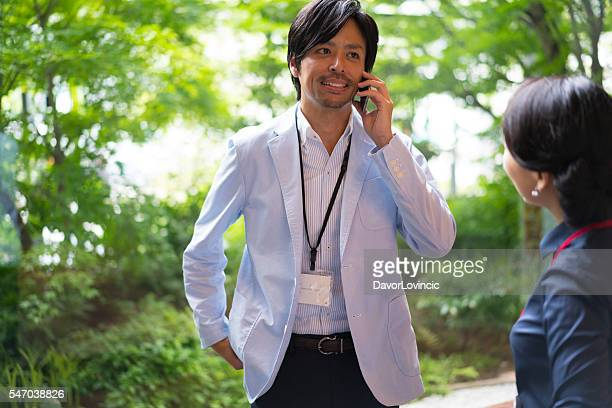 Businessman talking on mobile at Kyoto Research Centre, Japan