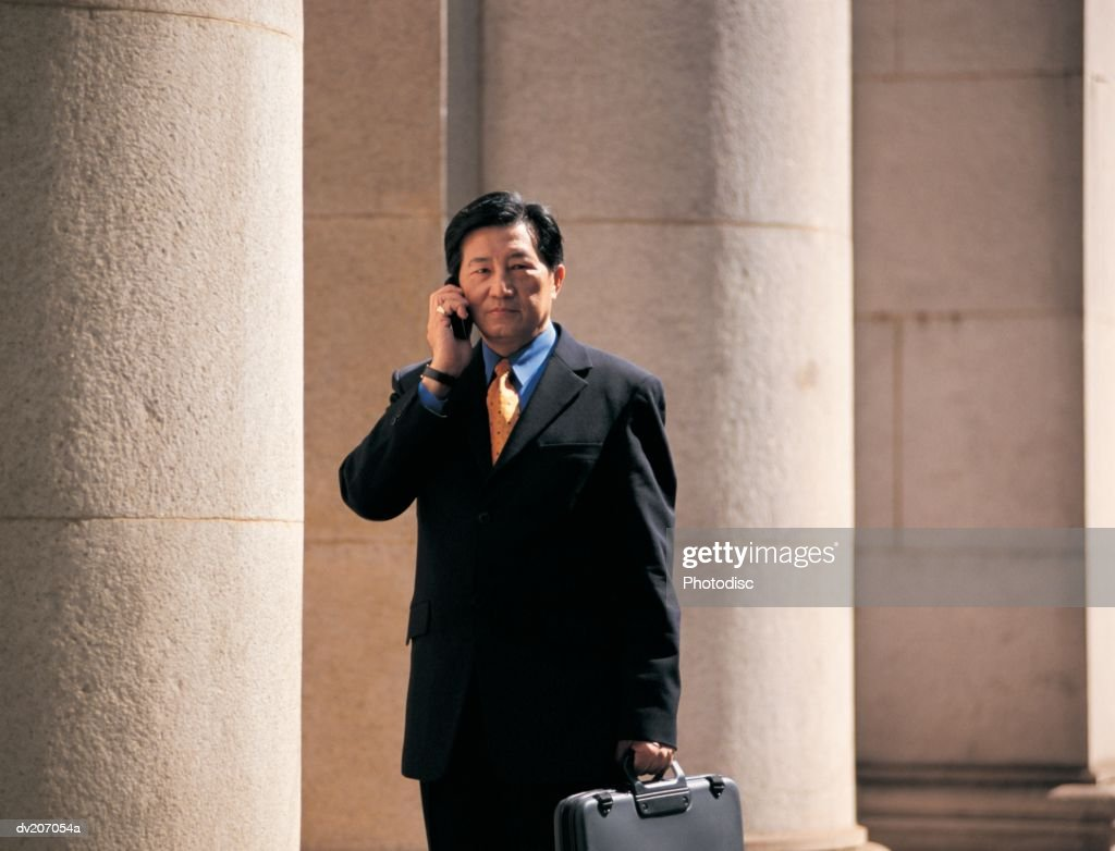 Businessman talking on phone : Stock Photo