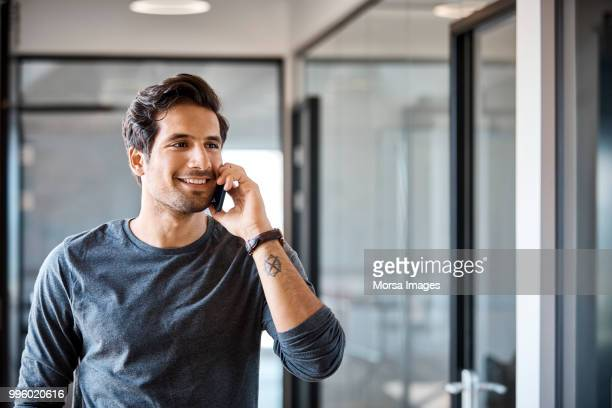 Businessman talking on smart phone at office