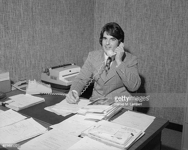 businessman talking on telephone and writing - {{relatedsearchurl(carousel.phrase)}} stock pictures, royalty-free photos & images