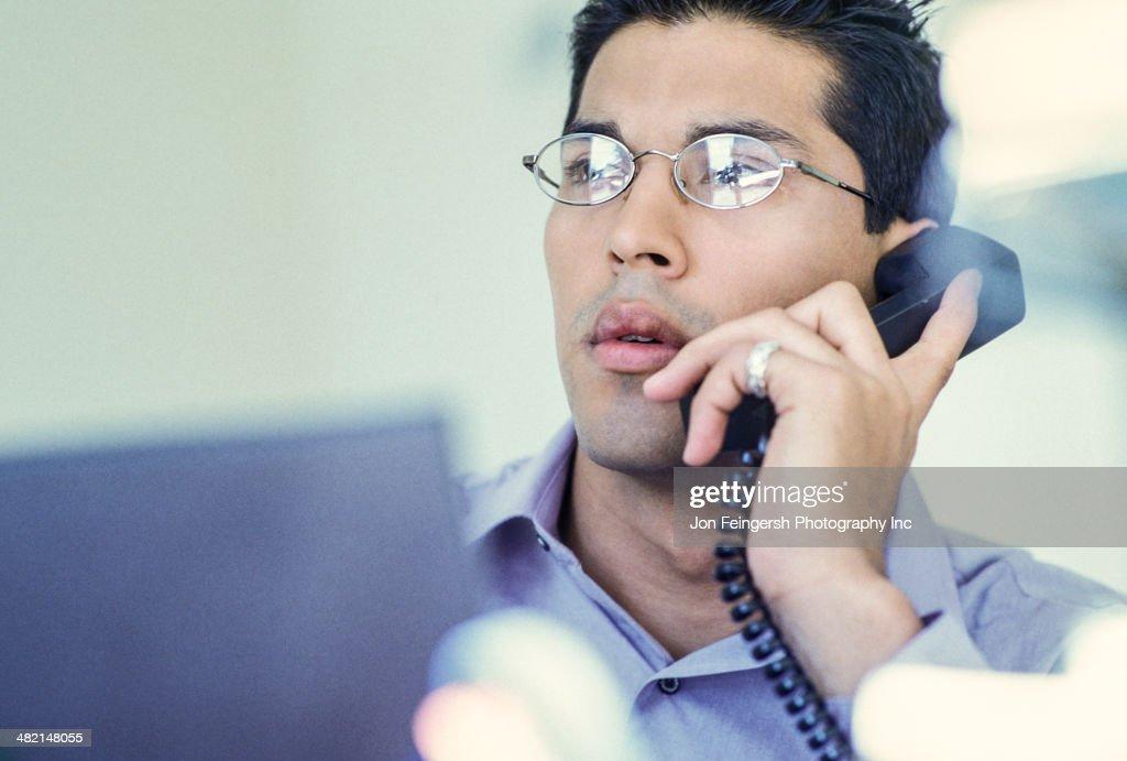 Businessman talking on telephone : Stock Photo