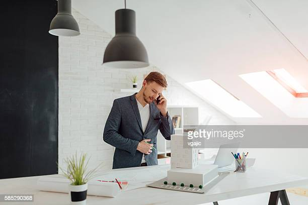 Businessman Talking On The Phone In His Office.