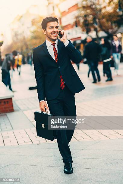 businessman talking on the phone - red suit stock pictures, royalty-free photos & images
