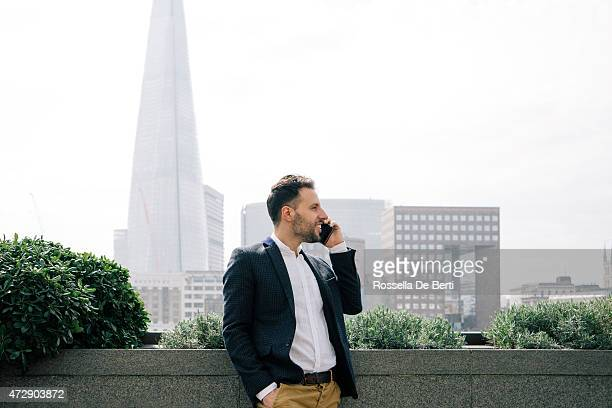 Businessman Talking On The Phone, The Shard On Background