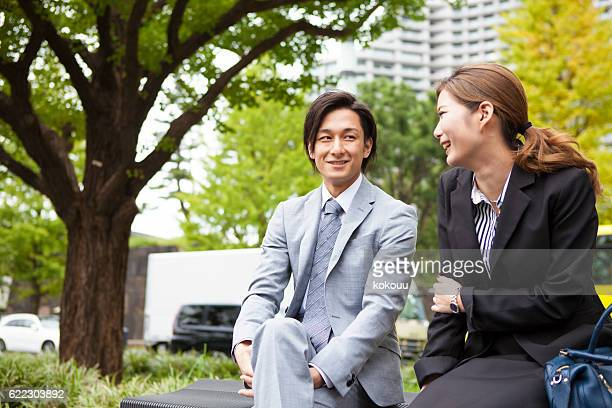 Businessman talking to a lover happily in the park