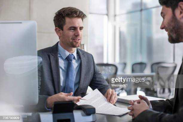 Businessman talking to client in office
