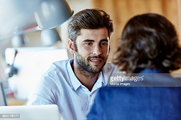 Businessman talking to colleague in office