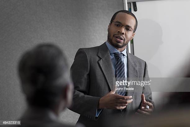 Businessman talking to colleagues in meeting