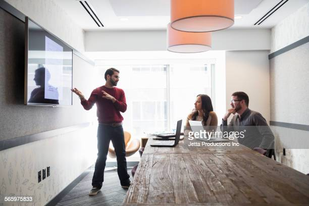 Businessman talking to colleagues in office meeting