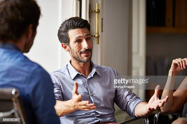 Businessman talking to colleagues