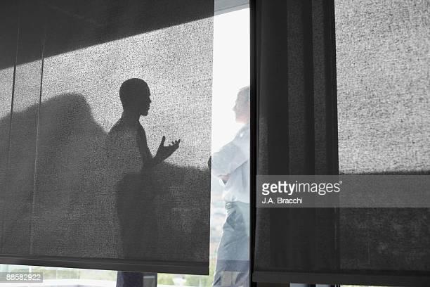 Businessman talking to co-worker on balcony
