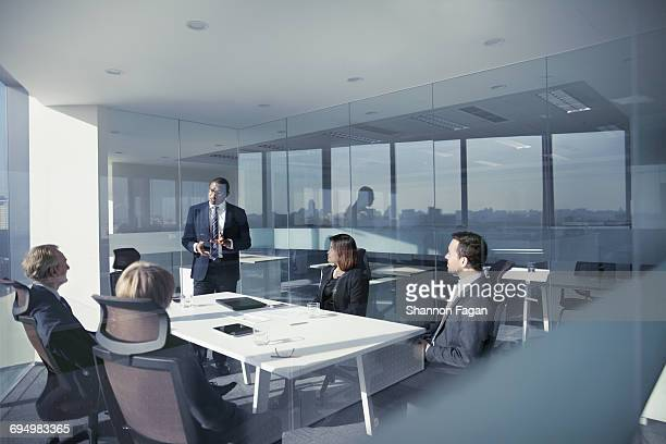 Businessman talking with colleagues in meeting