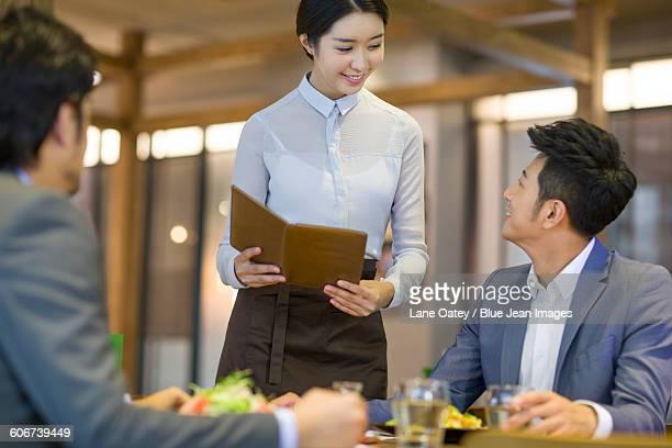 Businessman talking with waitress