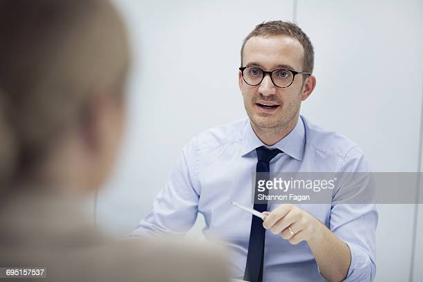 Businessman talking with woman in meeting room