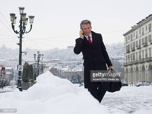 Businessman talks on cell phone, en route to work