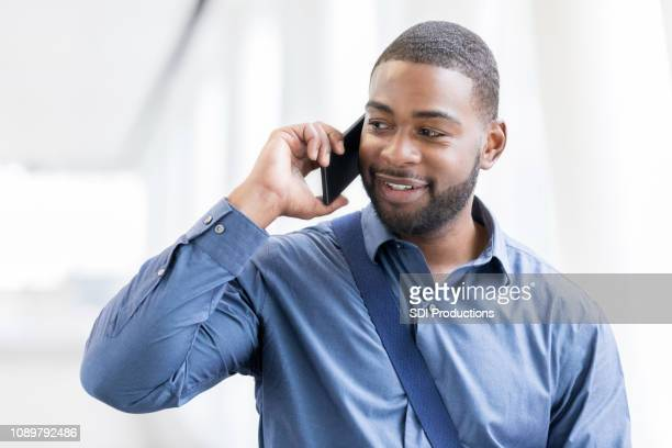 businessman talks on his phone - businesswear stock pictures, royalty-free photos & images