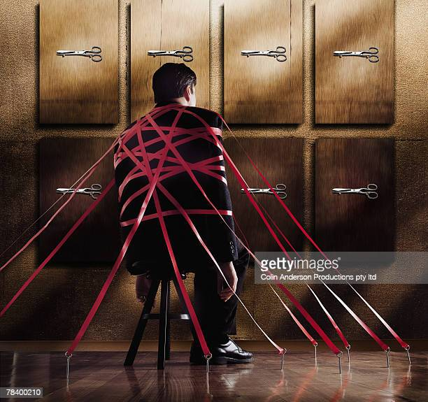 Businessman taped to chair