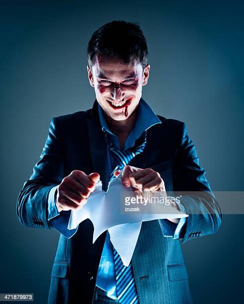 Businessman tearing paper