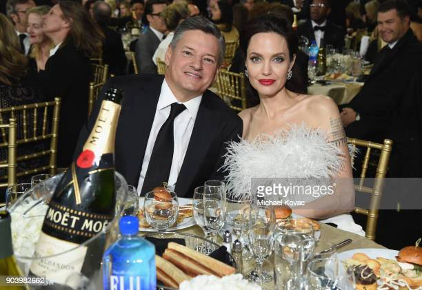 Businessman Ted Sarandos and actor Angelina Jolie attend Moet Chandon celebrate The 23rd Annual Critics' Choice Awards at Barker Hangar on January 11...