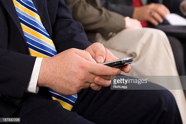 businessman text messaging - rich_legg stock pictures, royalty-free photos & images