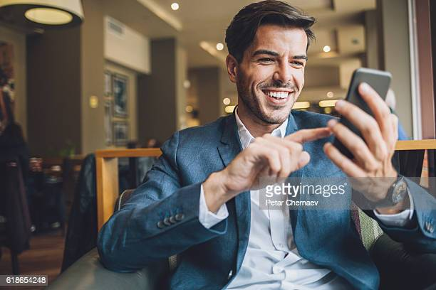 businessman texting in cafe - candid forum stock pictures, royalty-free photos & images
