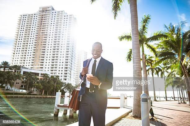 businessman texting in miami