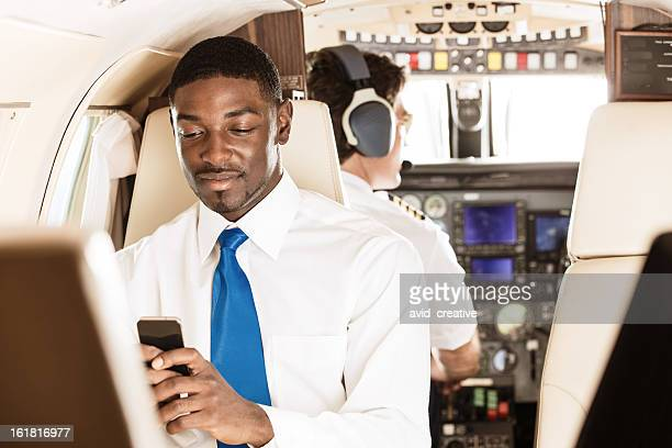 Businessman Texting on Phone in Private Jet