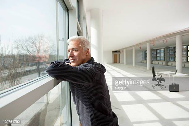 Businessman thinking about future office