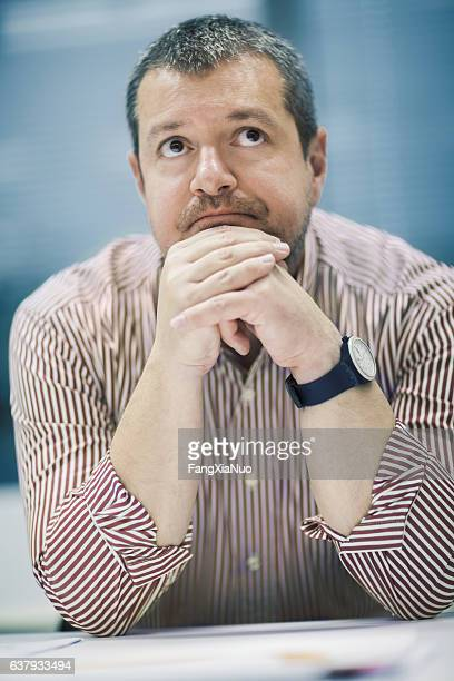 Businessman thinking in business office