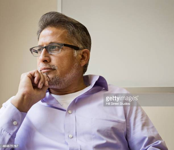 Businessman thinking in office