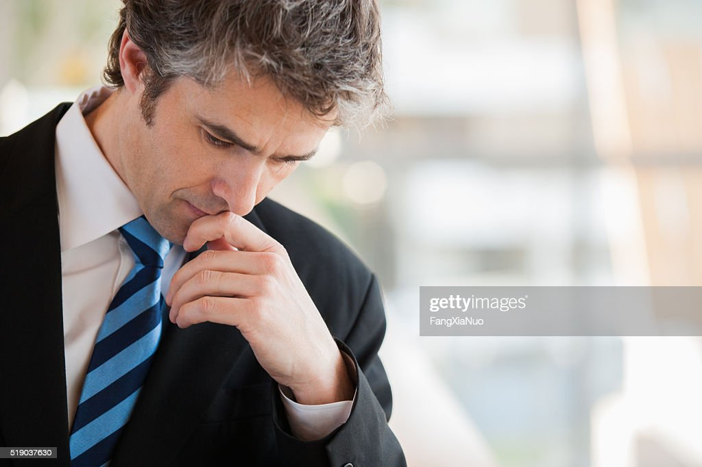 Businessman thinking : Stock Photo