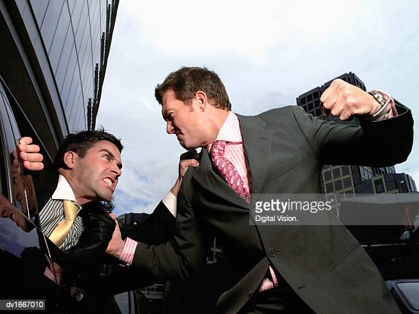 Businessman Threatening to Punch Another Businessman Sitting in His Car