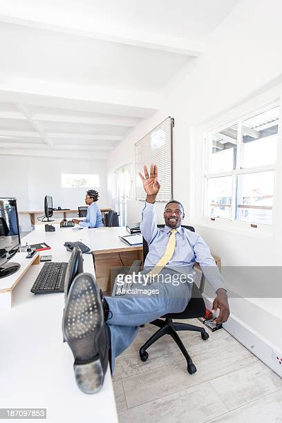 Businessman throwing a ball of crumpled paper in office.