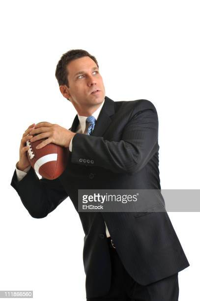 Businessman throwing football Isolated on White Background