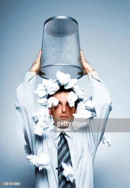 Businessman throwing paper on his head