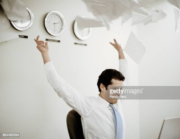 Businessman Throwing Paper