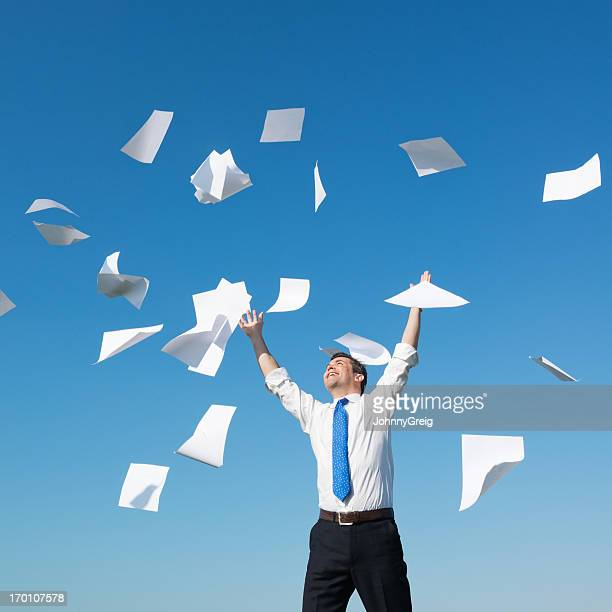 businessman throwing papers in the air - catching stock pictures, royalty-free photos & images