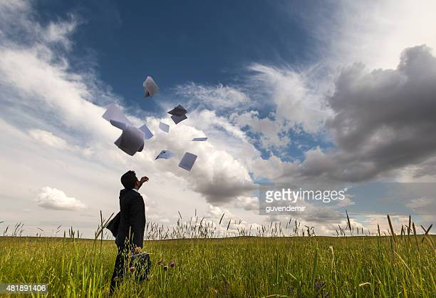 Businessman Throwing Papers in The Air
