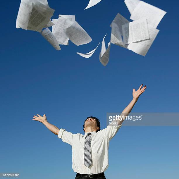Businessman throwing papers
