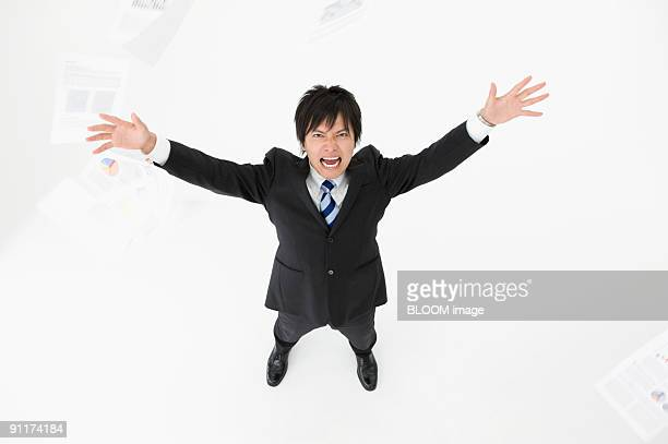 Businessman throwing sheets of papers in air