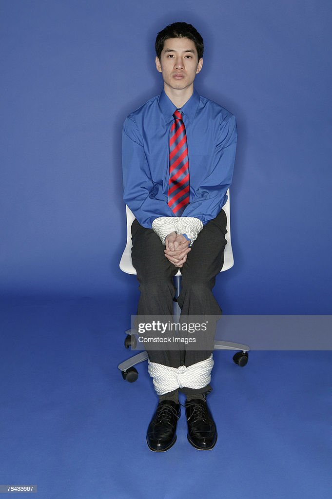Businessman tied up : Stockfoto