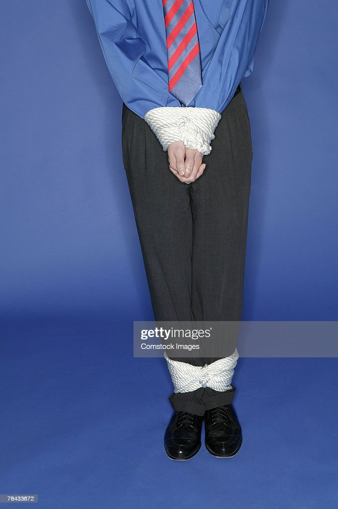 Businessman tied up : Stock Photo