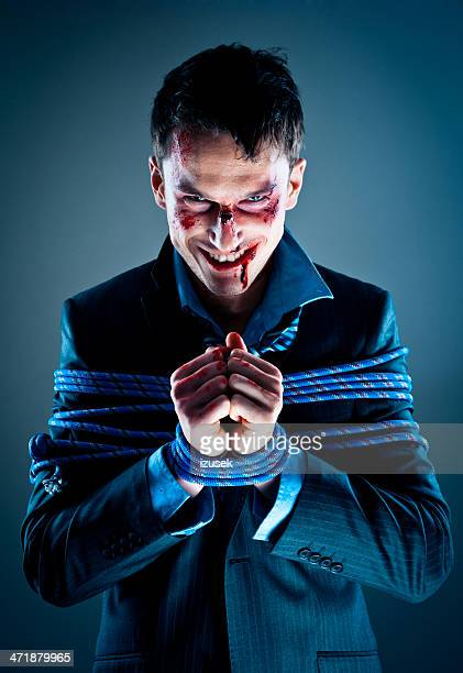 businessman tied up with rope - evil stock photos and pictures
