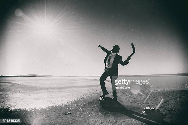 businessman tossing a boomerang to the sun - arrival photos stock photos and pictures
