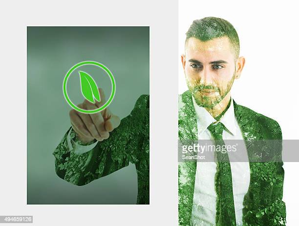 Businessman Touching an Eco Button