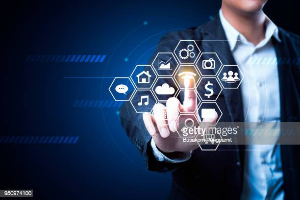 businessman touching future web technology buttons and icons with virtual display - campaign button stock pictures, royalty-free photos & images